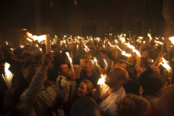 Worshippers hold candles as they take part in the Christian Orthodox Holy Fire ceremony at the Church of the Holy Sepulchre in Jerusalem's Old city